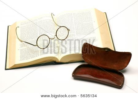 open bible with a pair of glasses