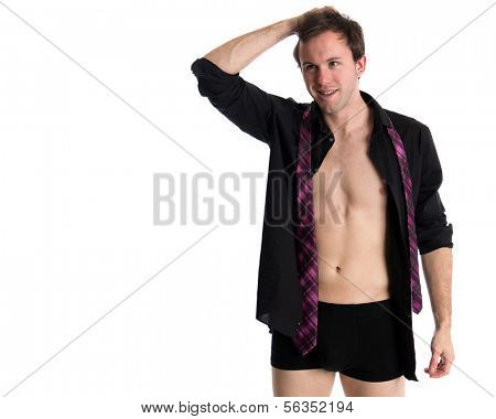 Young adult man with shirt open. Studio shot over white.