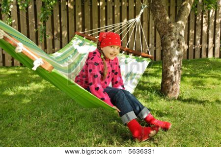 Little Girl Siting In Hammock