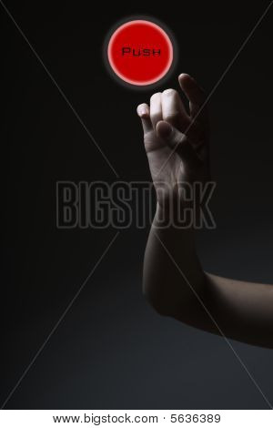 Finger Pressing The Red Button