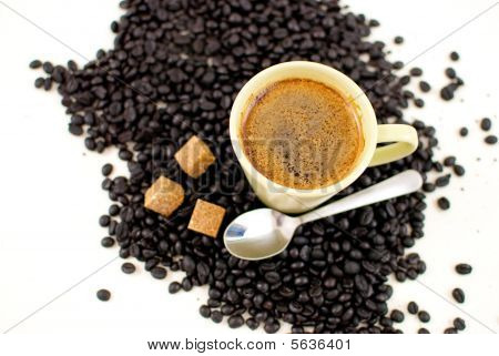 Coffee cup with beans and brown suger