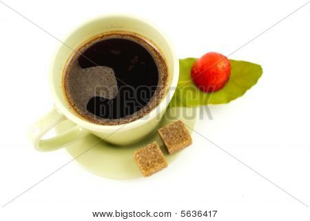 Coffee with teaspoon and cup