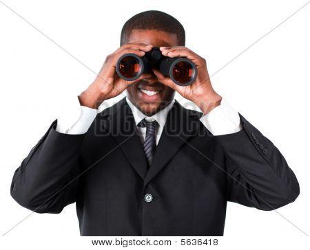 Close-up Of An Smiling Businessman Looking Through Binoculars