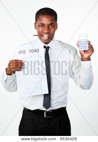 Angry Businessman Holding A Sheet And A Calculator