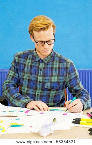 Product designer working on an innovative new product, sketching his ideas on paper