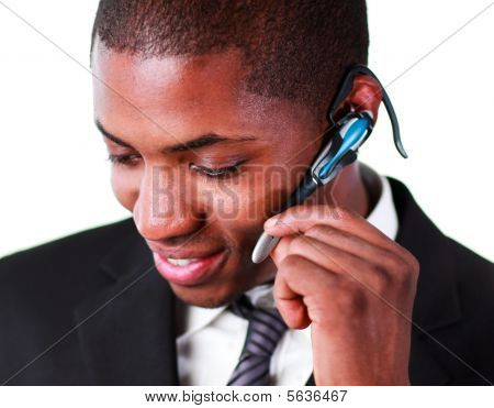 Close-up Of An Businessman Using An Earpiece