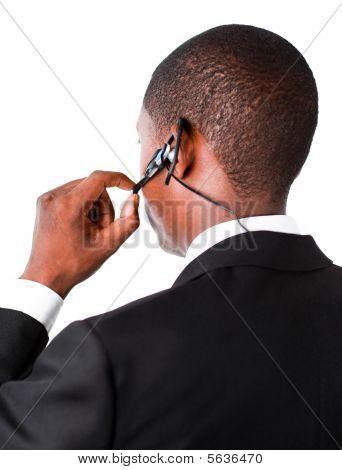 Businessman Showing His Earpiece
