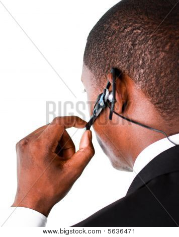 Close-up Of An Businessman Showing His Earpiece