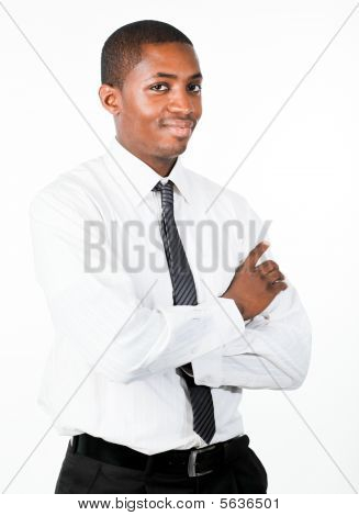 Portrait Of An Friendly Businessman With Crossed Arms