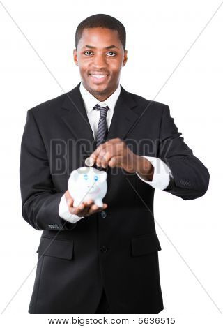 Businessman Putting Money In His Piggy Bank
