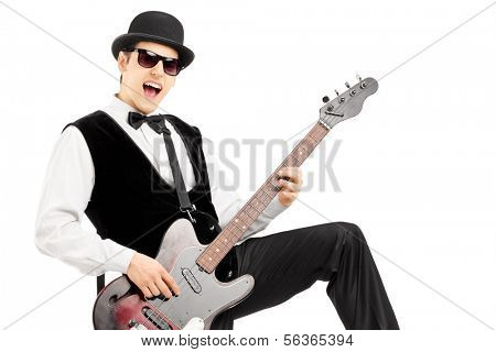Euphoric man playing a bass guitar isolated on white background
