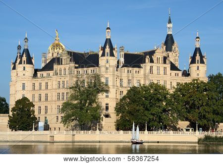 Sailing boat in front of the old castle of Schwerin