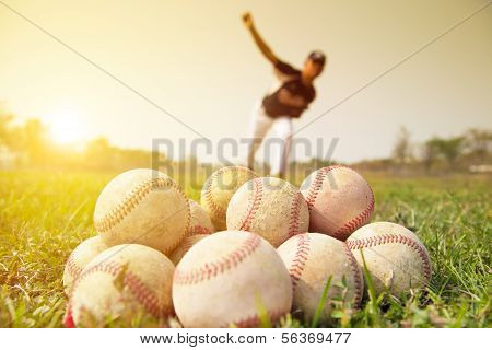 Baseball players practicing pitching outside