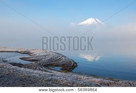Reflection of Mountain Fuji fujisan with mist at yamanaka lake
