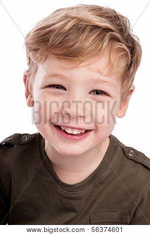 Happy Boy Looking Up To Camera.