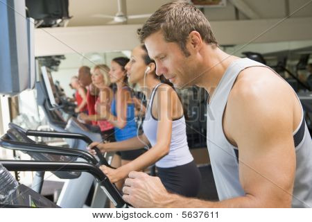 Man Running On Treadmill At Gym