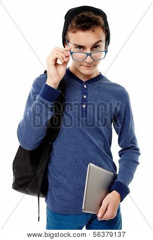 Teenager With Backpack Looking Inquisitve Above The Glasses