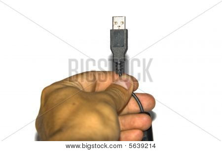 Hand Of A Man Holding A Usb Cable Isolated On White