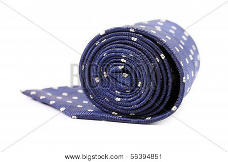 Folded blue tie with white speck.
