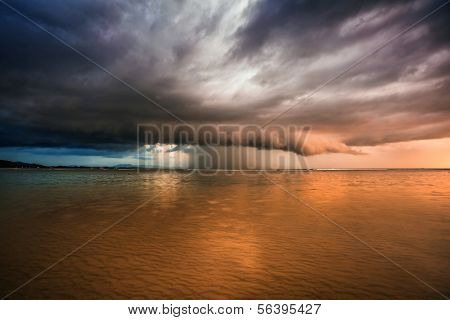 Thunder storm with roll cloud approaching the tropical beach after sunset