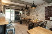 foto of keg  - Interior of French bistro with rustic furniture - JPG