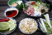 image of rice noodles  - Vietnamese rice noodles are served with beef lime hoisin sauce and chili sauce and ready to eat.