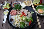 picture of rice noodles  - Vietnamese rice noodles are served with beef lime hoisin sauce and chili sauce and ready to eat - JPG