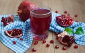 image of pomegranate  - Open pomegranate with seed and pomegranate juice on wooden background