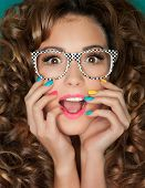 pic of nerd glasses  - Young attractive surprised woman wearing glasses - JPG