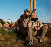 image of reining  - Young travellers couple in Reine village - JPG