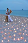 pic of marriage proposal  - A man propose marriage to woman at sea beach in many candle lights against sunset- St.Valentines Day romantic concept ** Note: Slight blurriness, best at smaller sizes - JPG
