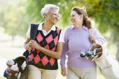 stock photo of senior adult  - Female Friends Enjoying A Game Of Golf - JPG