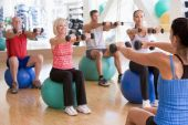 foto of senior class  - Instructor Taking Exercise Class At Gym - JPG
