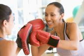 stock photo of boxing day  - Women Boxing Together At Gym - JPG