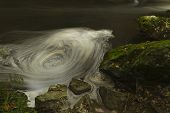 stock photo of anglesey  - Apparent whirlpool appears in long exposure - JPG