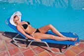 Young Blond White Woman On Sunbed