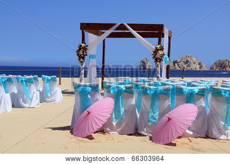 Beach wedding ceremony set up in Cabo San Lucas. Also available in vertical.