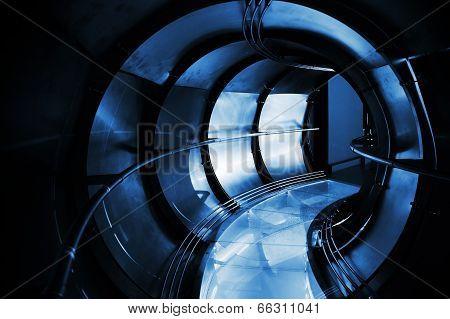 Abstract Underground Industrial Sewerage. Dark Blue Metal Tunnel Interior