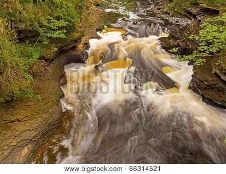 Water And Rocks In A Forest Stream