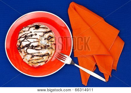 Choux Pastry Served With Orange Table Setup On Blue