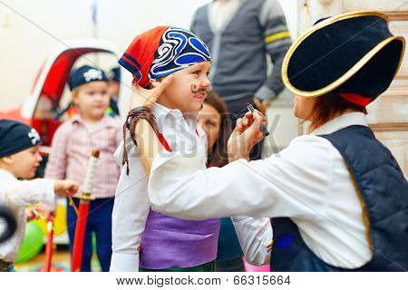 Woman Painting Kid's Face On Party