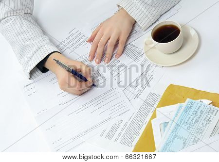 Business woman working with tax documents