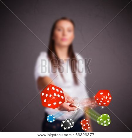 Pretty young woman throwing dices and chips