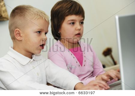 Childrens Have Fun And Playing Games On Laptop Computer
