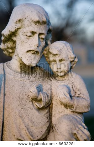 Statue of Father holding Baby Jesus