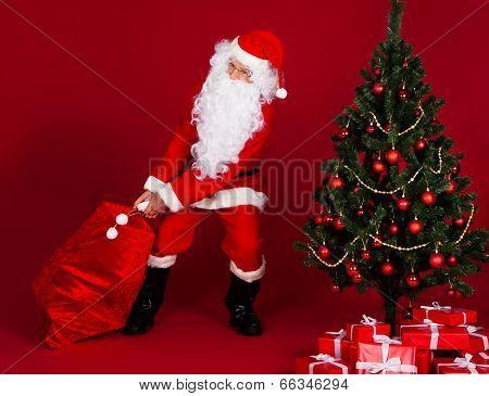 Santa Pulling Gifts Sack