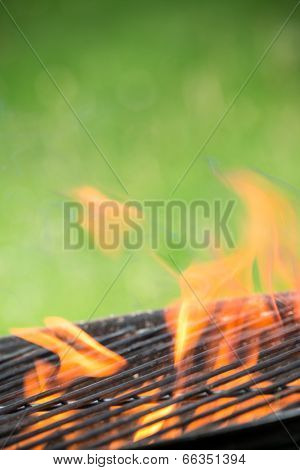 Empty grill on garden with burning embers