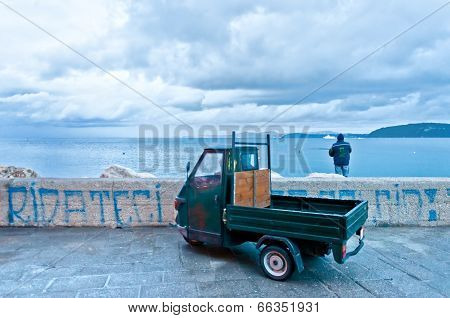 fisherman and harbor in Ischia island, Italy
