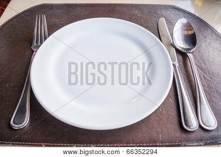 White Plate With Spoon Knife And Fork