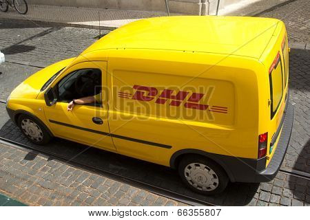 LISBON, PORTUGAL - MAY 29, 2014: A DHL delivery van on the street in the city center Lisbon. DHL is a world wide courier company that operates in 220 countries with over 285,000 employees.